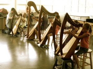 young kids trying harps