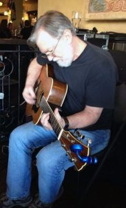 Ken Fleming playing guitar