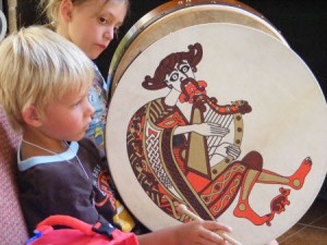 boy and girl playing Irish drums